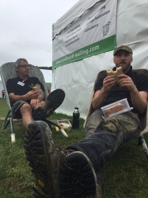 Dan and Mick Eating Lunch in Wheelbarrows